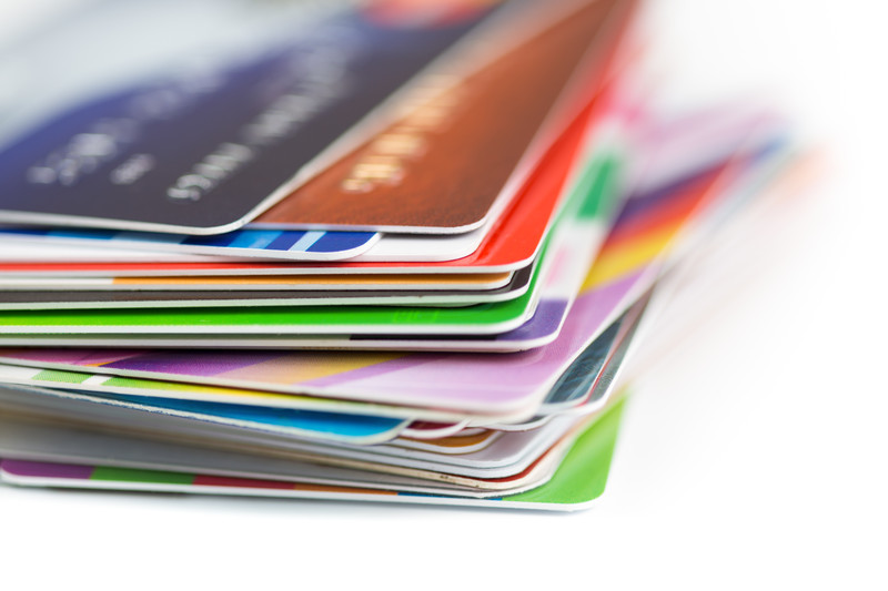 Stack of credit cards. Should you refinance or consolidate credit card debt?