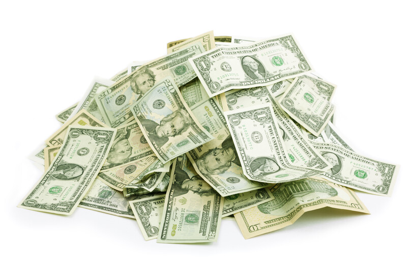Pile of money - how are installment and payday loans different
